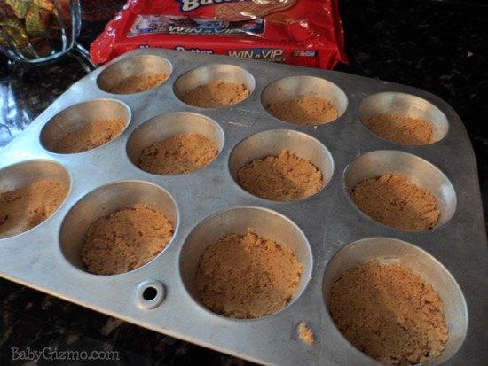 peanut butter crust in a muffin pan