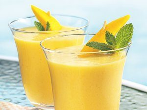 creamy mango smoothies 570dcfa7 20ca 4b75 912f 294bbb0f9205 ss 10 Summery and Fun Mango Recipes!