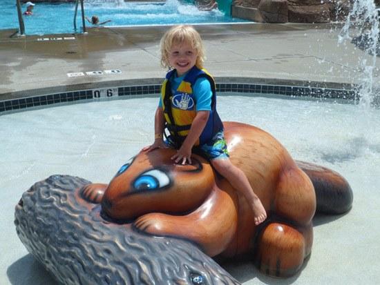 little boy at water park