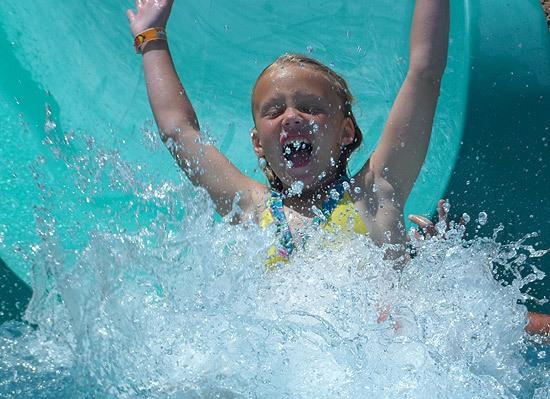 little girl on water slide