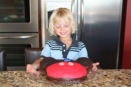 toddler with Mickey Mouse Cake