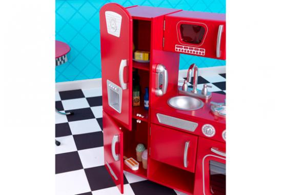 red play kitchen with black and white floor