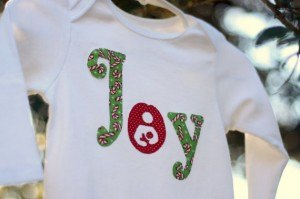 long sheeve onesie with joy on it