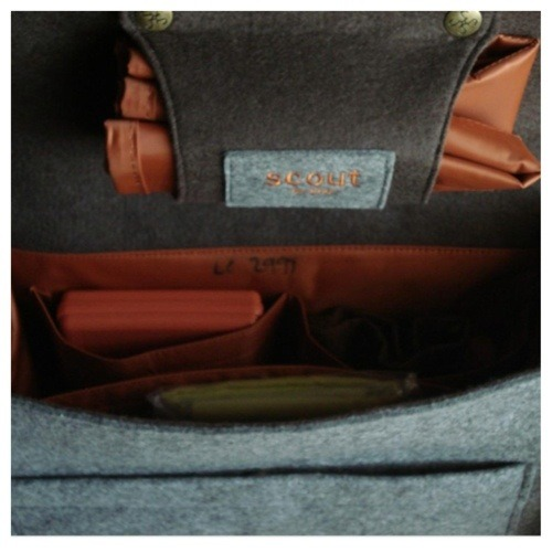 inside of a grey diaper bag