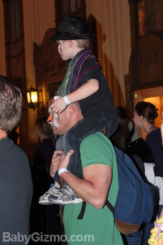 little boy on dad's shoulders