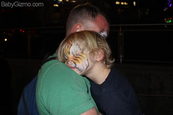 little boy sleeping on dad's shoulders