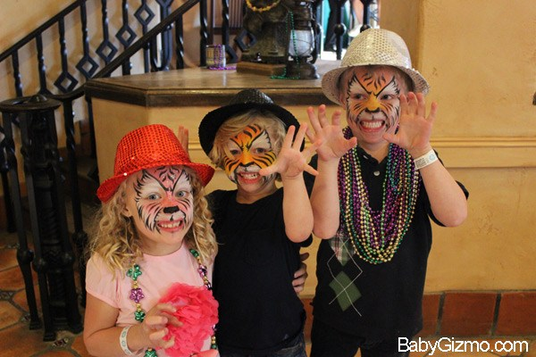 three kids with tiger faces