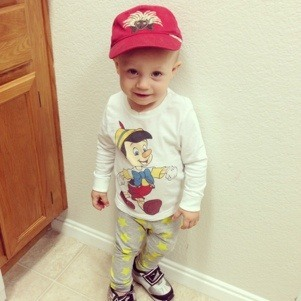 toddler with red hat