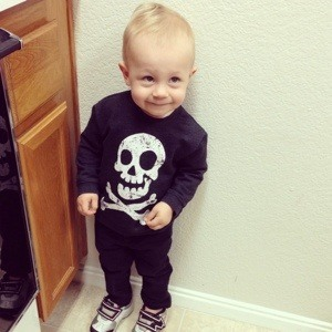 toddler with skull and bones tshirt