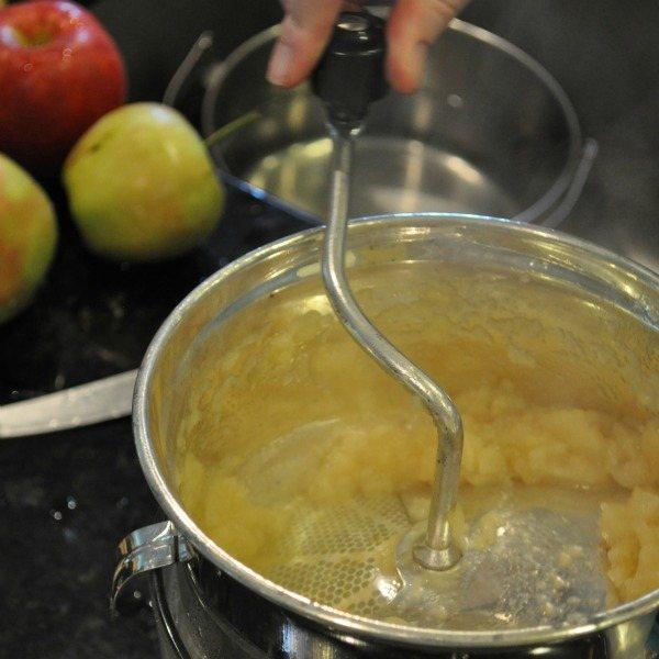 mashing apples