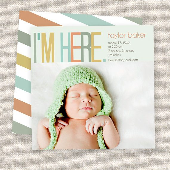 baby with green hat birth announcement