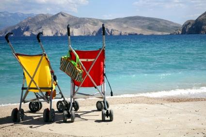2 strollers on a beach