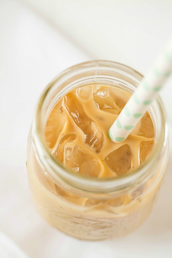 Iced coffee in a mason jar with a straw