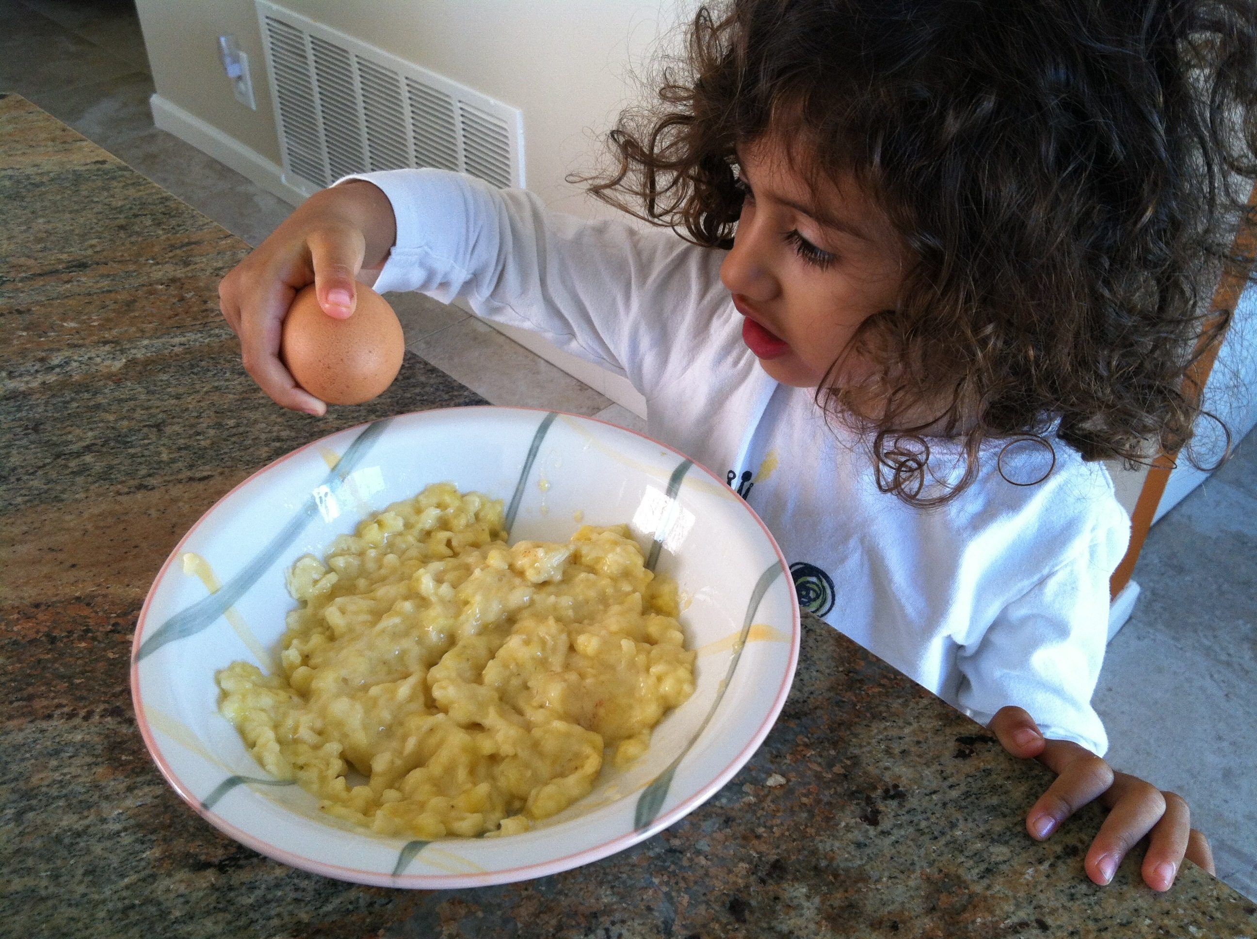 little girl eating scramble