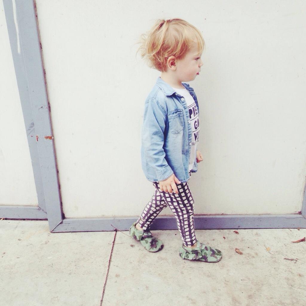 baby walking down street