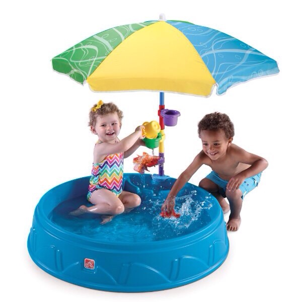 two toddlers in play pool