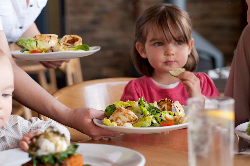 toddler eating at restaurant
