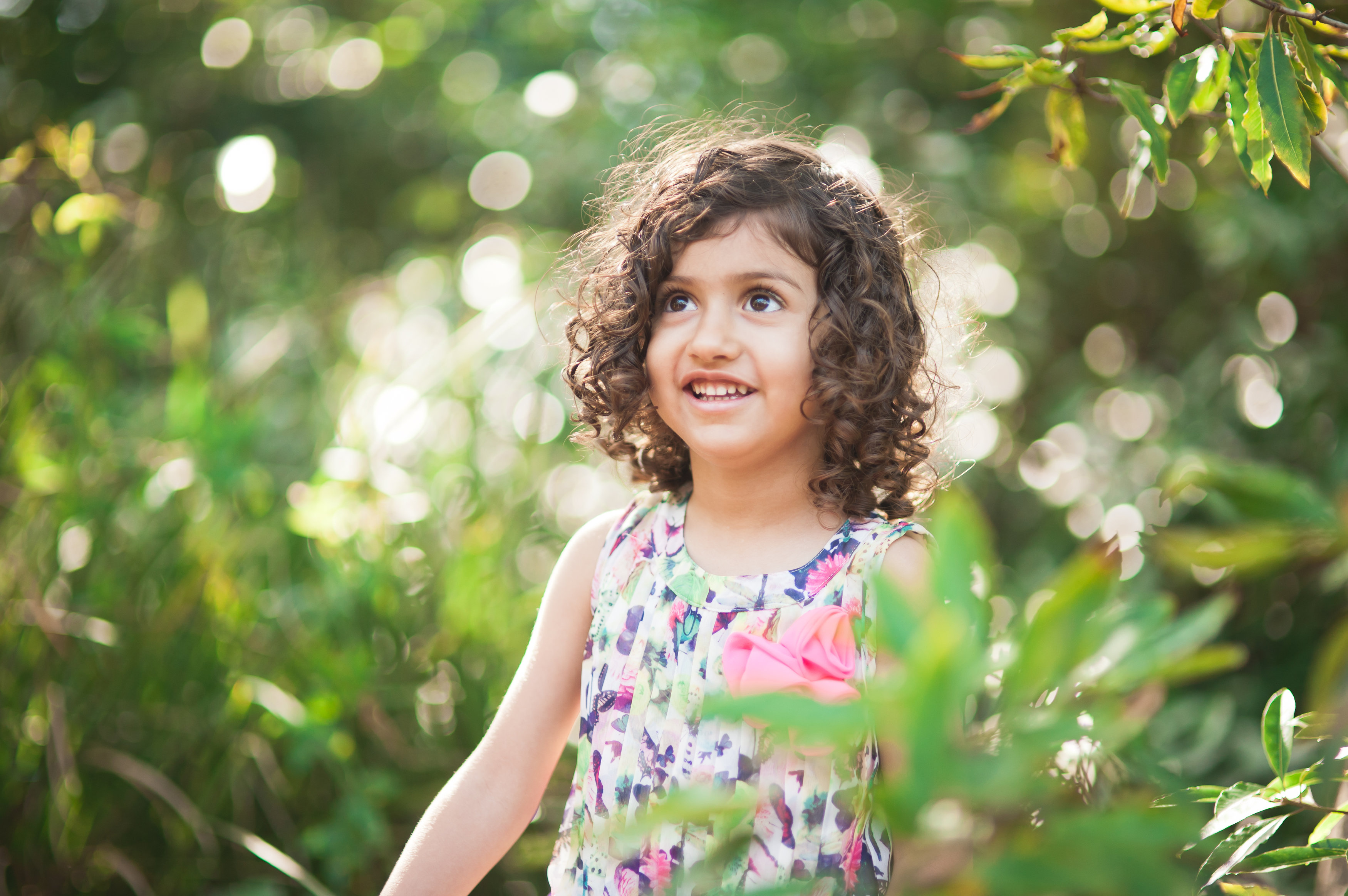 little girl with brown curly hair