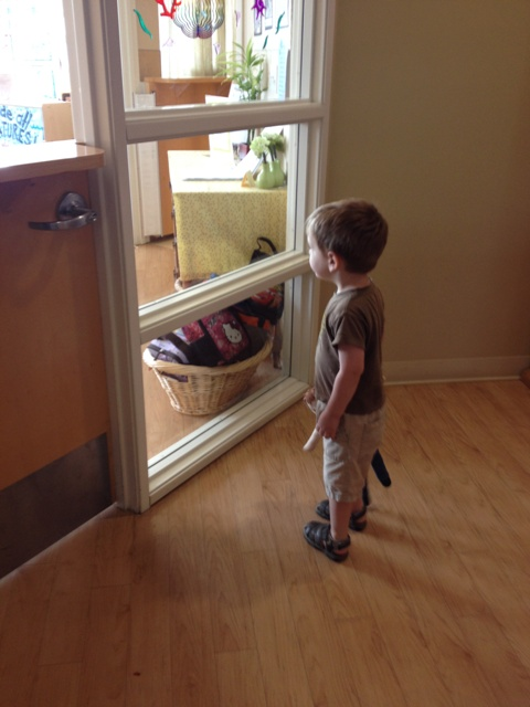preschooler looking through window
