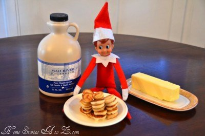 elf on the shelf with a plate of pancakes