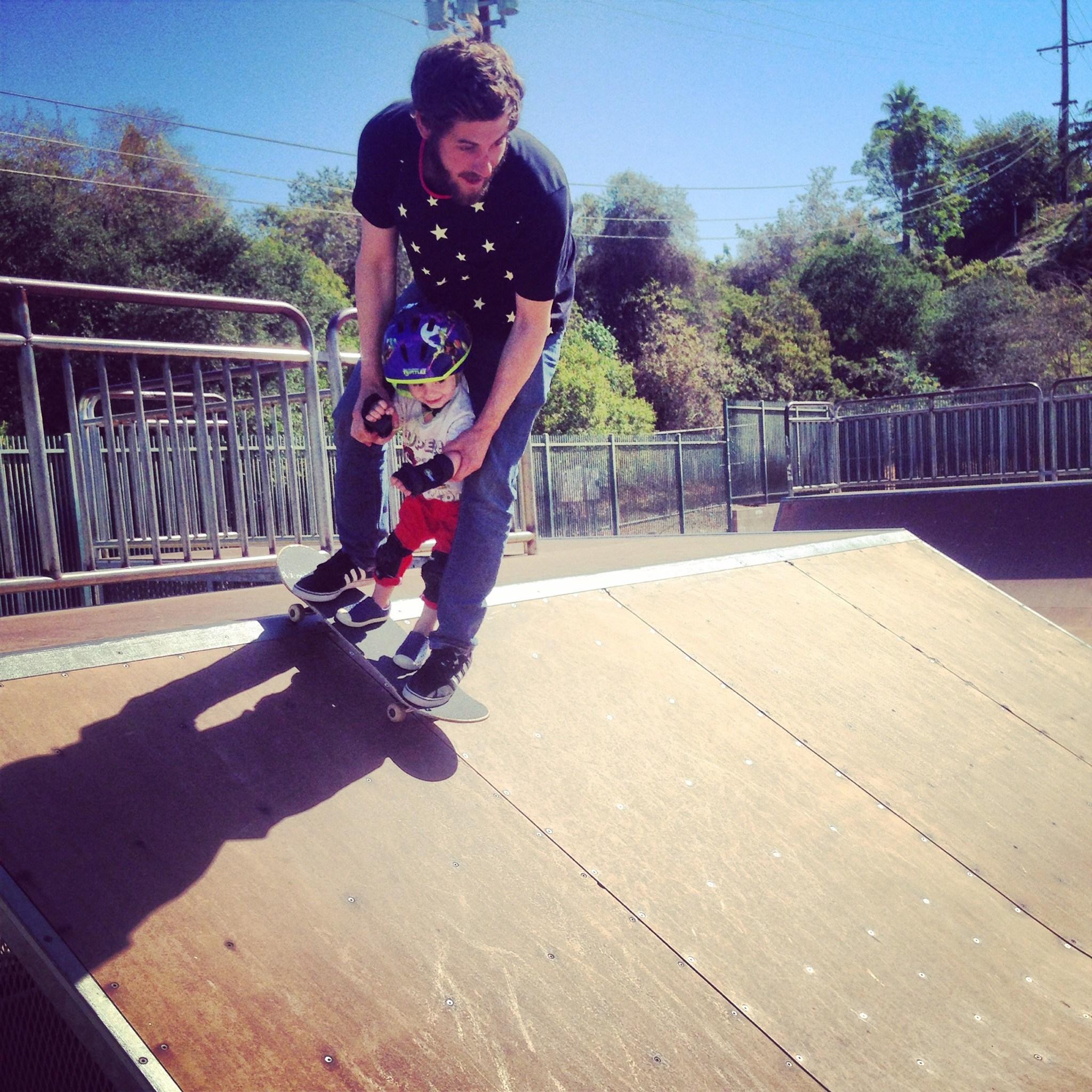 toddler and dad skateboarding