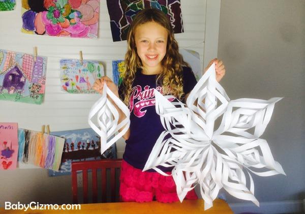 girl holding 3d snowflake