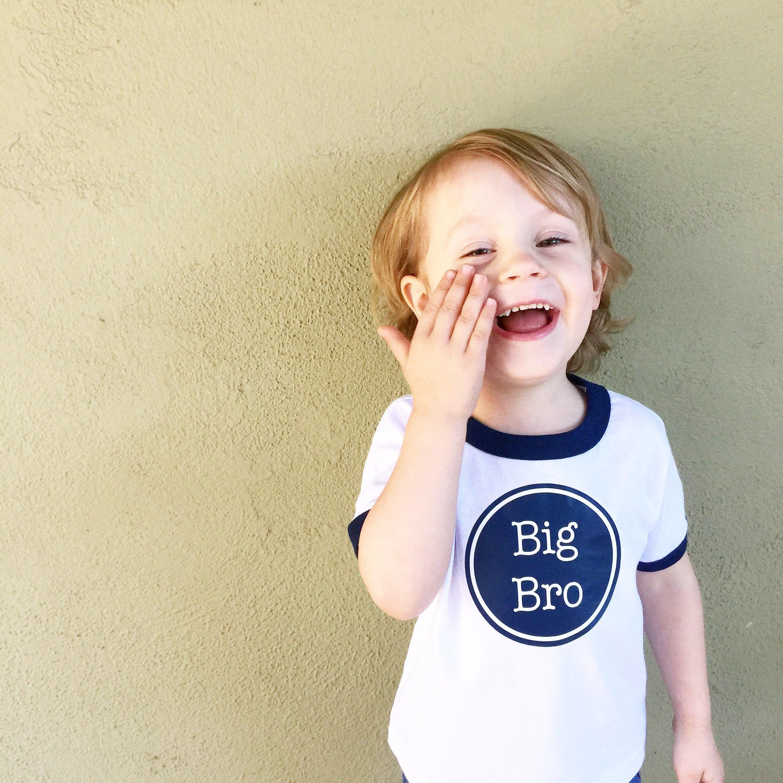 little boy with big bro shirt