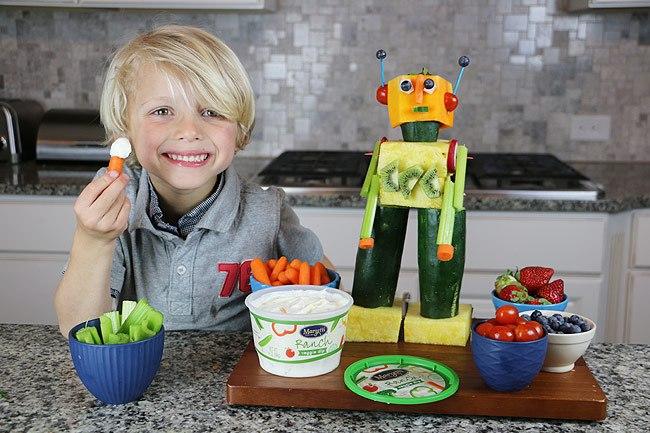 little boy eating carrots