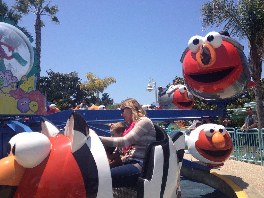 mom and child on amusement ride