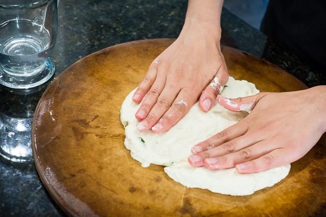 spreading naan dough