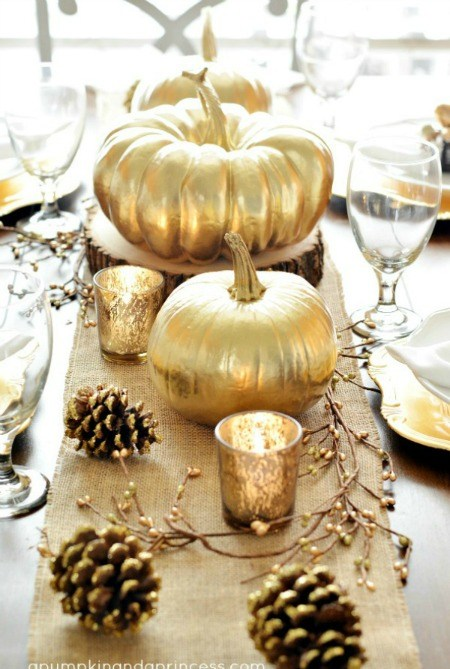 gold pumpkins on a table
