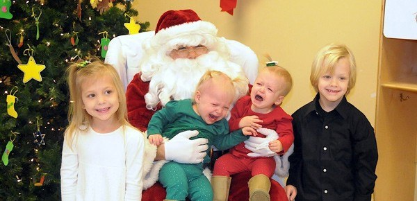 twins crying with santa