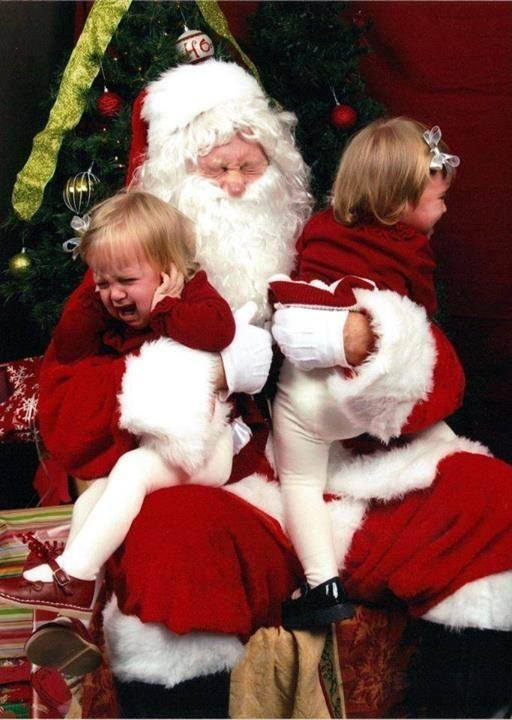 two kids screaming with santa