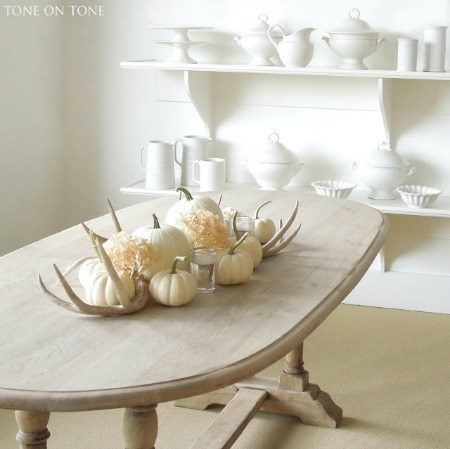 white kitchen with white pumpkins on table