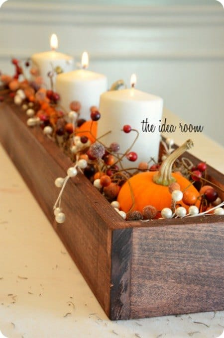 wood box with candles and pumpkins