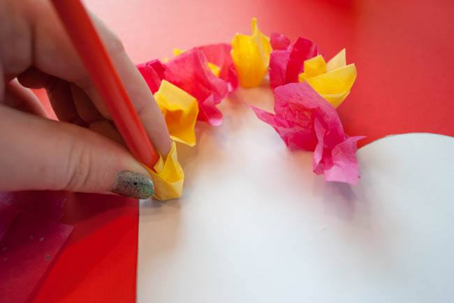 Press tissue paper on
