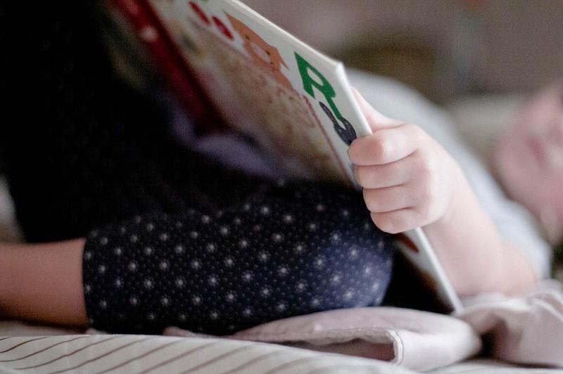 little girl child reading book