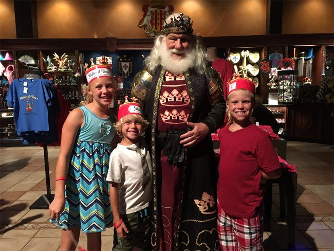 kids with king at Medieval Times