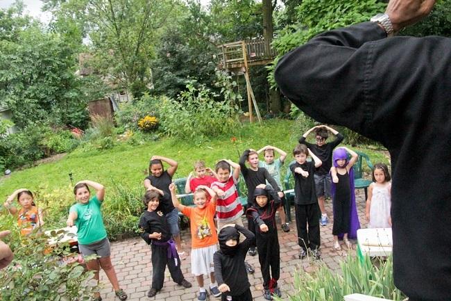 kids playing simon says in backyard