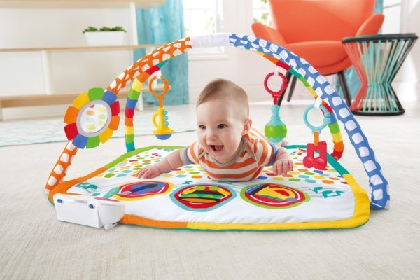 baby on colorful playmat