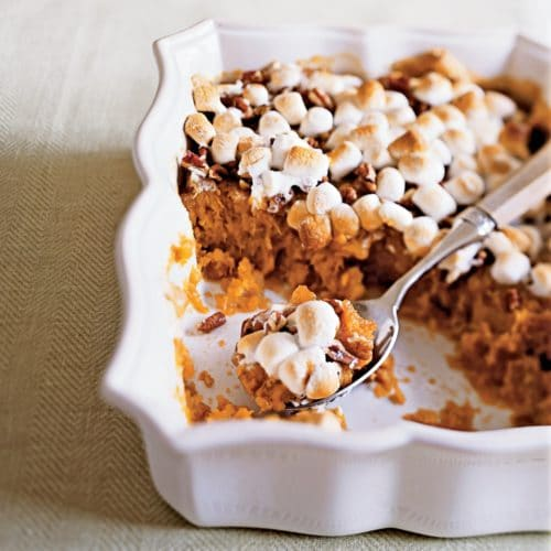 sweet potatoes with marshmallows in white dish