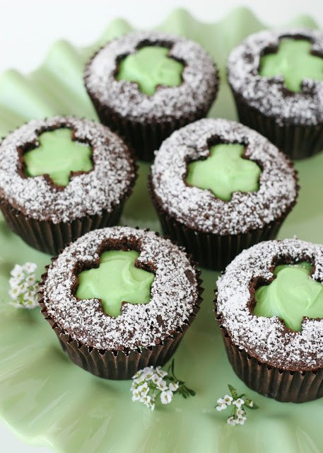 chocolate cupcakes with green shamrock cut out