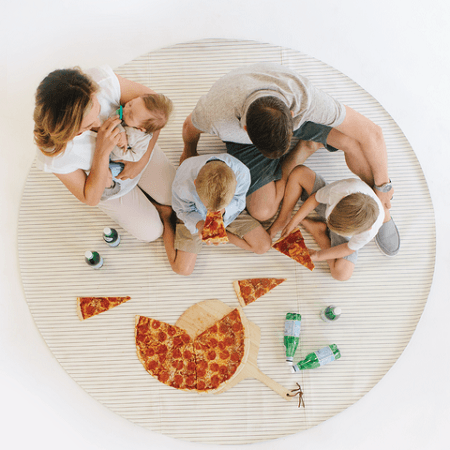 Gathre Leather Mat with family eating pizza