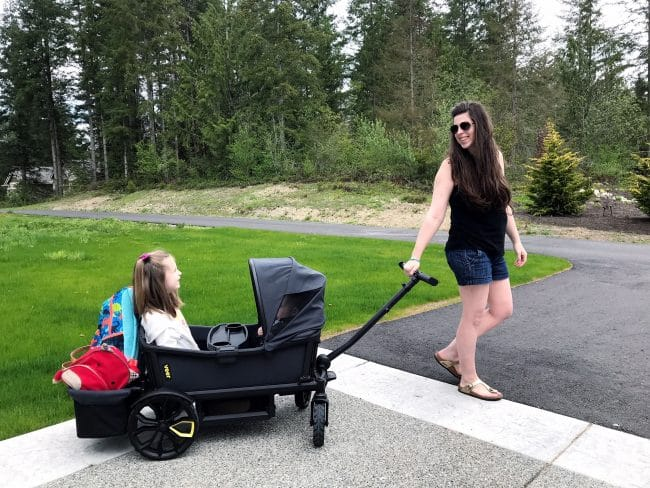 mom pulling the veer wagon with toddler