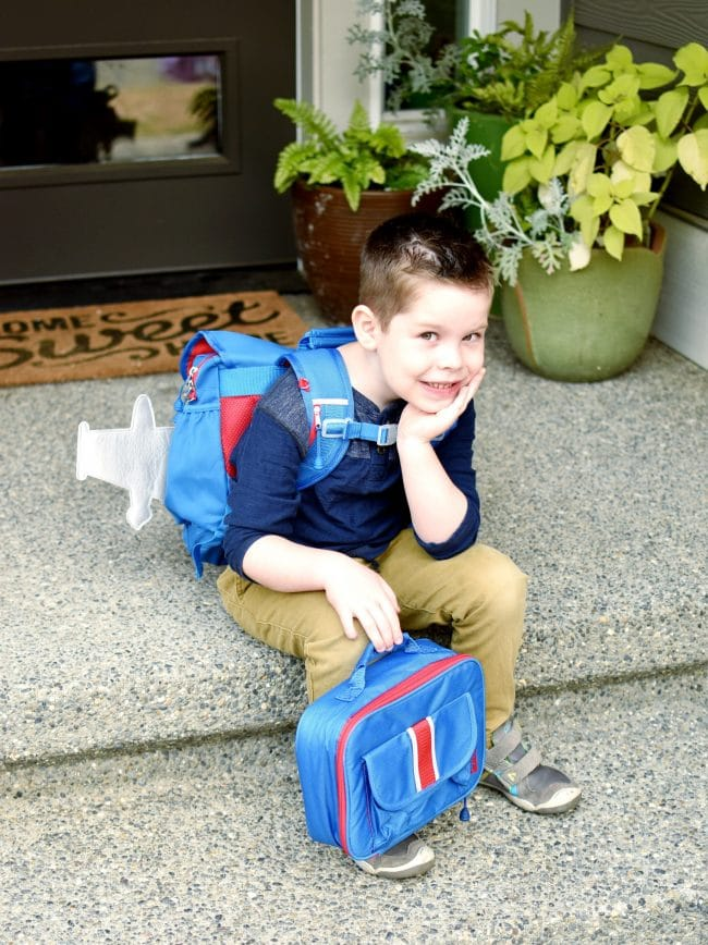 little boy with airplane backpack