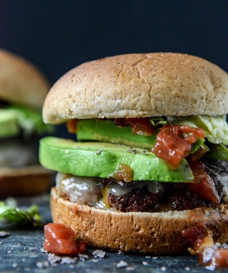taco-rubbed burgers with avocado and crushed tortilla chips meal