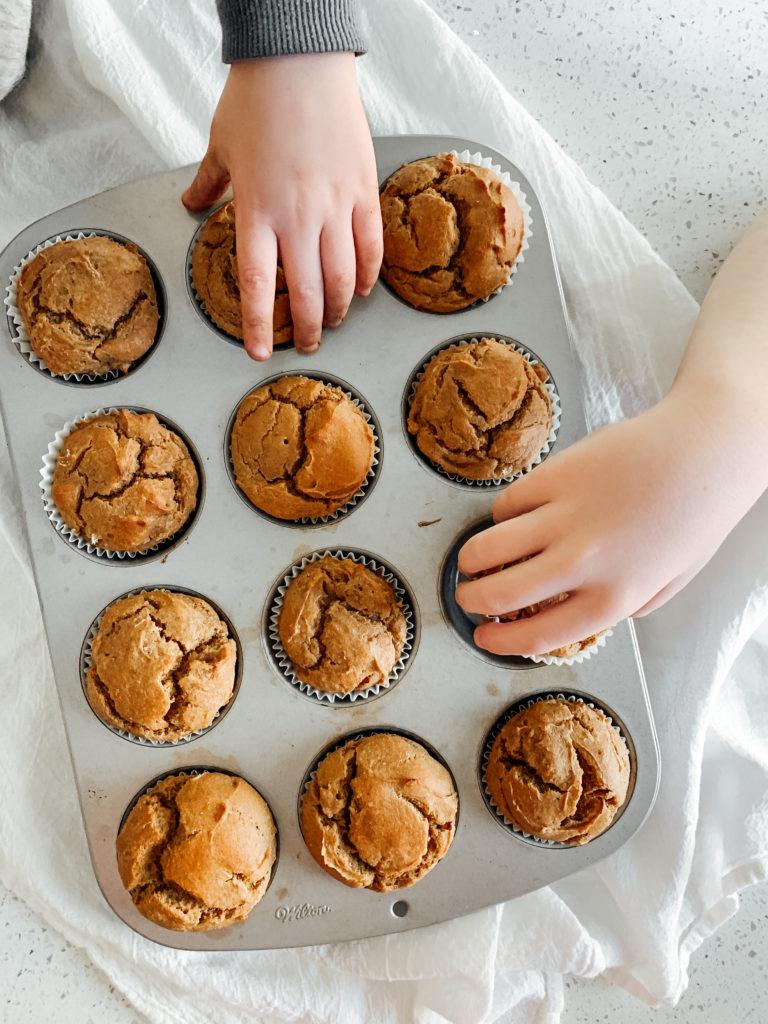 hands grabbing muffins
