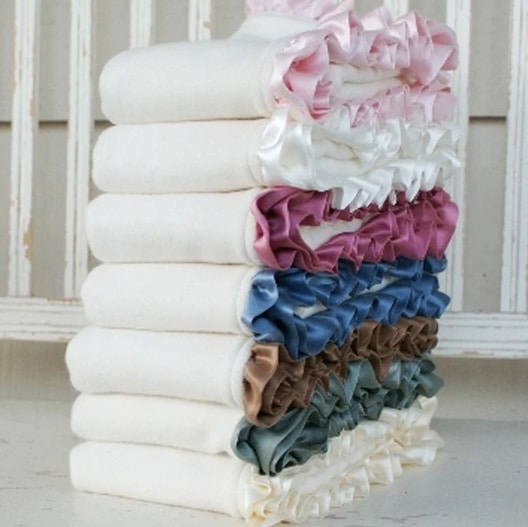 stack of organic baby blankets