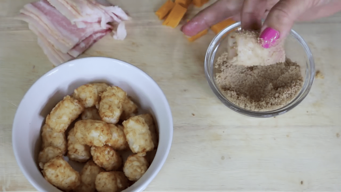 putting bacon in brown sugar