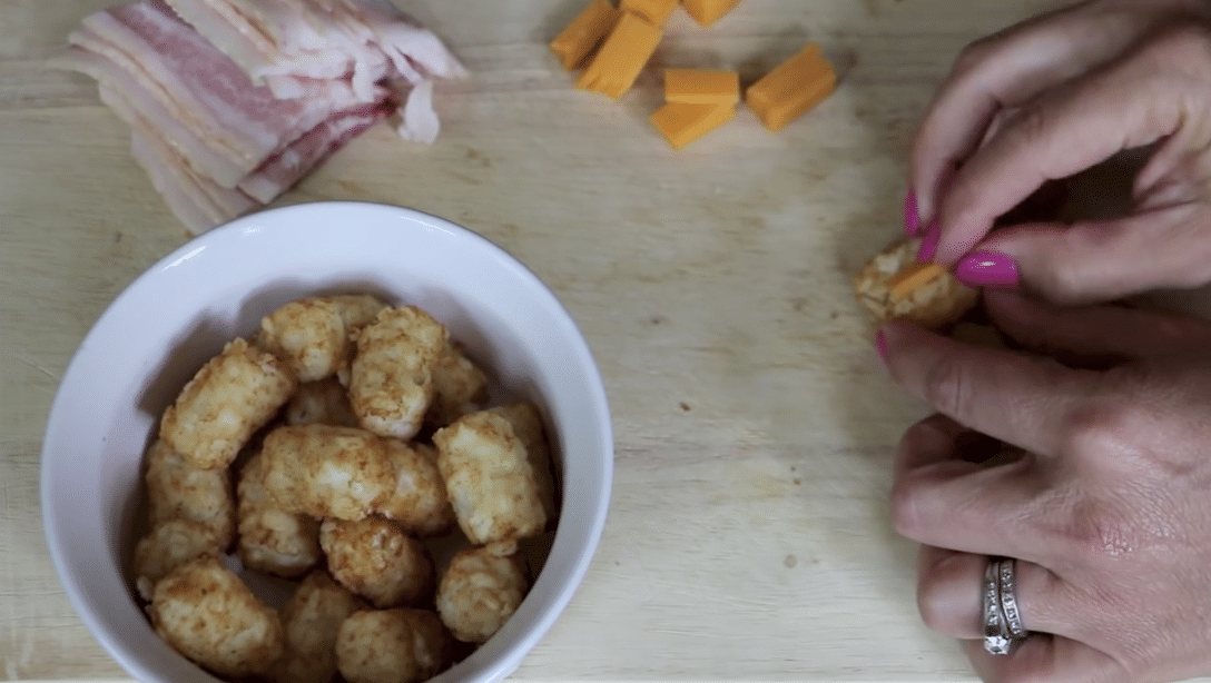 putting cheese in tater tots